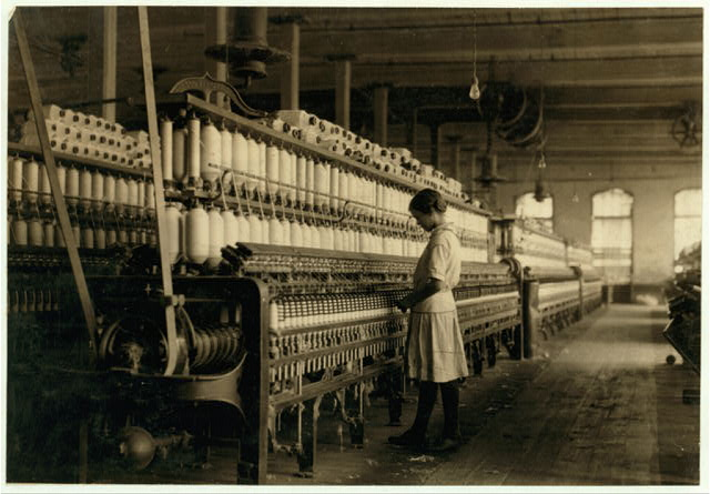 Fourteen year old spinner in a[?] Brazos Valley Cotton Mill at West. Violation of the law. Matty Lott runs six sides. See family group and their story.  Location: West, Texas.