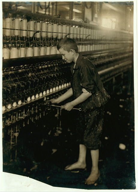 American Linen Co. Cleaner - Spinning room.  Location: Fall River, Massachusetts