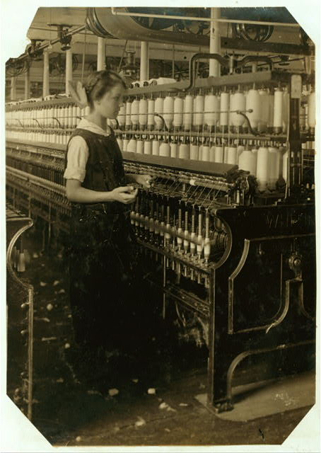 King Philip Spinning Room. Spare hand on spinning frames. Alphonsine Berube, 831 Globe St. Age - 15 years.  Location: Fall River, Massachusetts