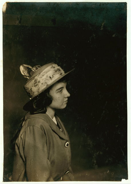 [Aldea Balanger - French - Weaver. Cornell Mills - 14 years old July 12, 1915, getting her certificate for her 5th position. Face broken out as most of weavers have from the machine oil, handling it and not washing hands. Lint gets into pores.] Location: Fall River, Massachusetts