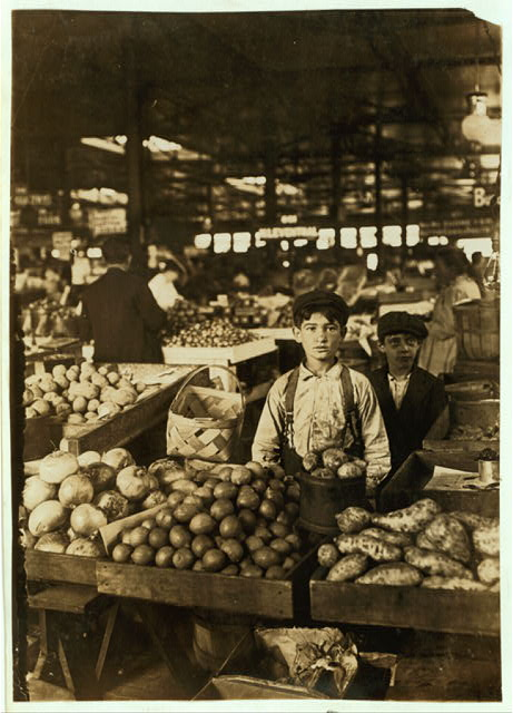 Fruit Vendors, Indianapolis Market, aug., 1908. Wit., E. N. Clopper.  Location: Indianapolis, Indiana.