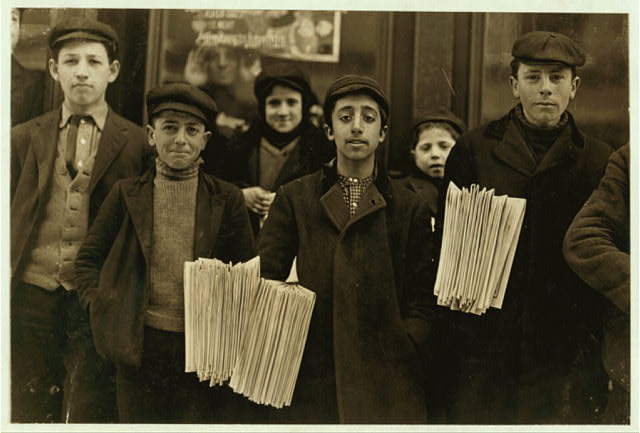 Hartford, Conn., newsboys. Boy in middle, Joseph De. Lucco, has been selling for 8 years. Was arrested for stealing papers a while ago.  Location: Hartford, Connecticut.