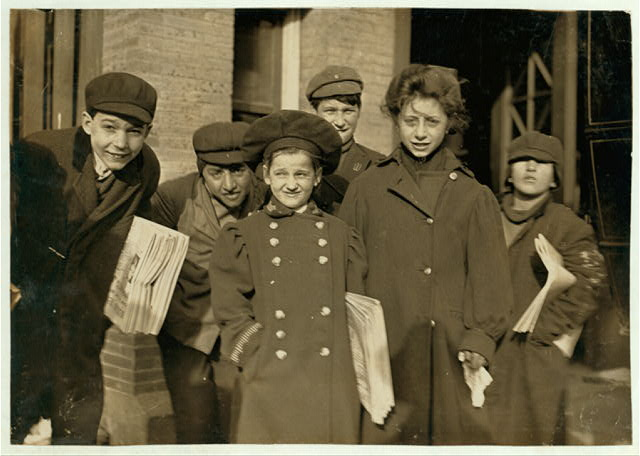 Hartford newsboys and girls. Girl in middle, Nellis, is 9 years old. See label on photo 640. [Caption #640: A 9 year old newsgirl in Hartford, Conn. She sold later than this sometimes. Been selling two years.]  Location: Hartford, Connecticut.