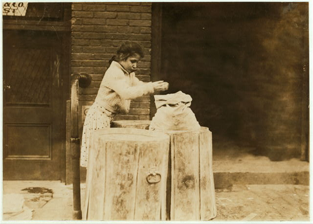 Picking over ash barrels. Boston, Mass., Oct. 1909. L.W.  Location: Boston, Massachusetts.
