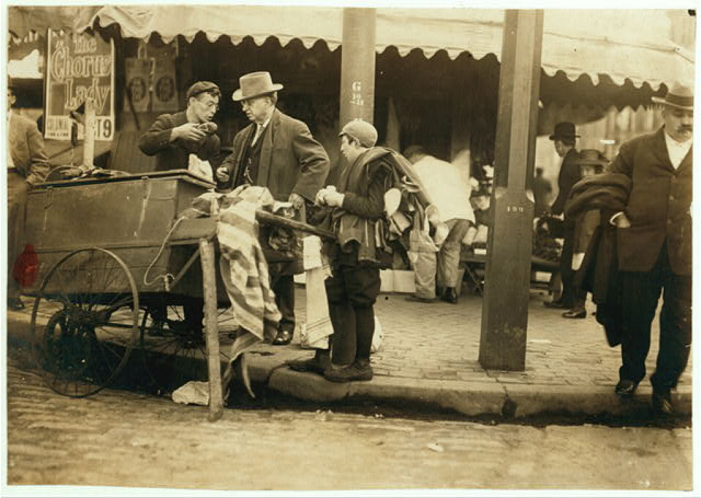 A Typical Errand Boy Minding Another Boy's Business. Boston 1915 Exhibit.  Location: Boston, Massachusetts.