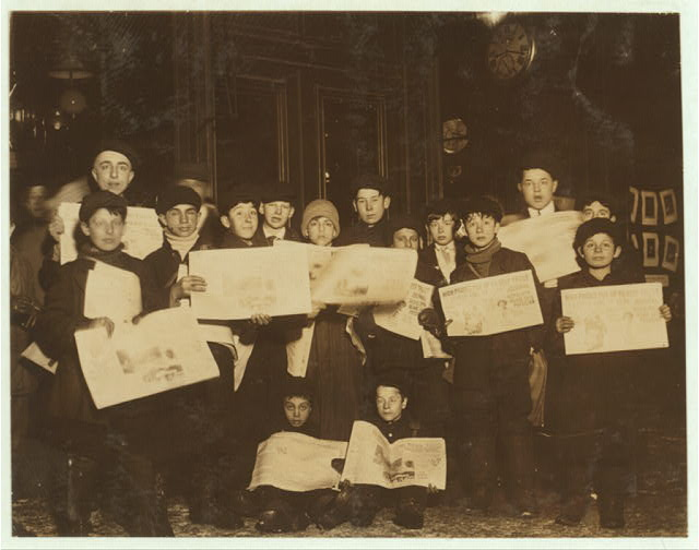 A group of newsies collected in a few minutes on Main Street at 9 P.M.  Location: Buffalo, New York (State)