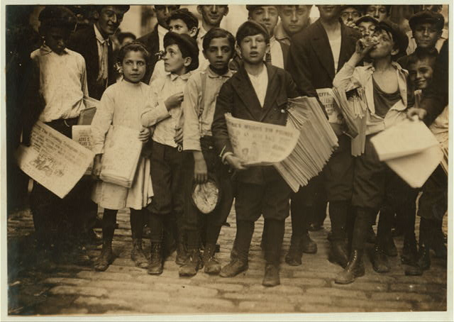 [Newsboys and newsgirl. (Mary Malchade) (9 years old.) Getting afternoon papers, Park Row.]  Location: New York, New York (State)