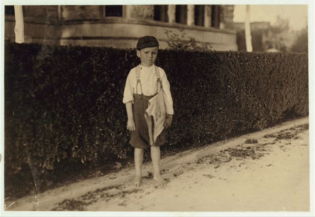 Six year old newsboy. Raymond Miller. Many of these here ranging from five to ten years old.  Location: San Antonio, Texas.