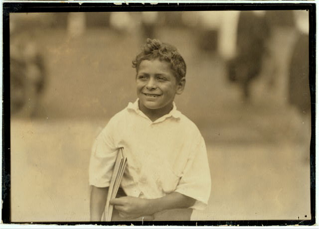 Patsy, eight year old newsboy, Newark, N.J. Says he makes fifty cents a day. - Aug. 1, 1924.  Location: Newark, New Jersey.