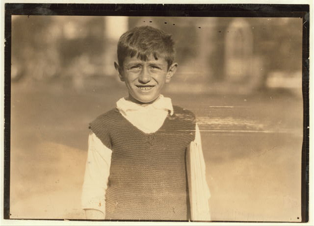 On the Green at New Haven, Conn. One of the young newsboys - Aug. 26, 1924.  Location: New Haven, Connecticut.