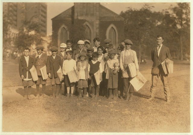 Group of newsboys from 7 years to 21. There were no newsgirls at this time. On the Green at New Haven, Conn. Aug. 26, 1924.  Location: New Haven, Connecticut.