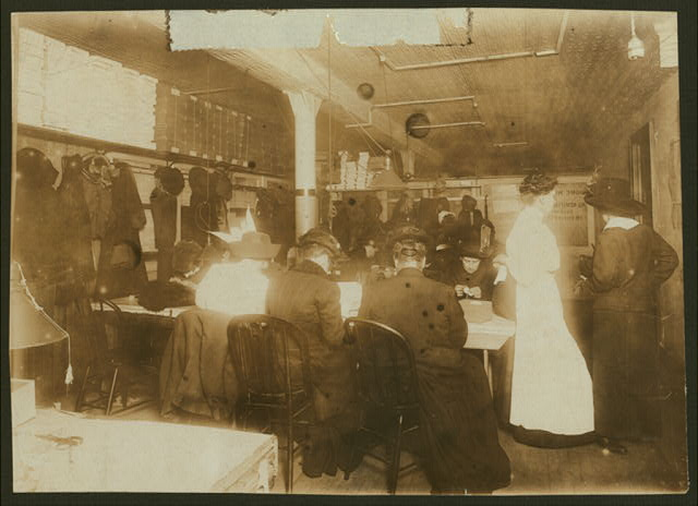 Room in Martini's factory (beading slippers, etc.), 249 Hud[son]. Women are calling for home-work, also delivering it, and learning to do it.  Location: New York, New York (State)
