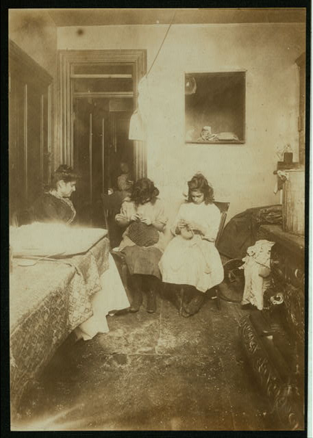 Florence Valentino, 12 yrs. old, and sister Jennie, working on crochet hats in dirty kitchen tenement, 3126 Jerome Ave. (Bronx). They make heavy hats, muffs, scarfs, slippers, etc. Jennie, 15 yrs. old, works in a Tremont Av. factory part of the time. Can make 1Πdozen heavy hats in half a day. Florence makes five hats in half a day, being in school only half a day. Have been at it one year.  Location: New York, New York (State)