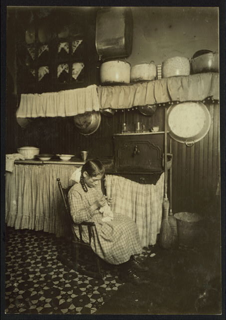 Carmela Picciano, 311 E. 149th St., 3[rd] fl[oor] rear. 12 years old. Making Irish lace for collars. Works until 9 P.M. sometimes. Dirty kitchen.  Location: New York, New York (State)