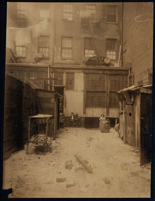 Rear view of tenement, 134 1/2 Thompson Street, New York City. See Photos of flower makers working here (2778 and 2816).  Location: New York, New York (State)