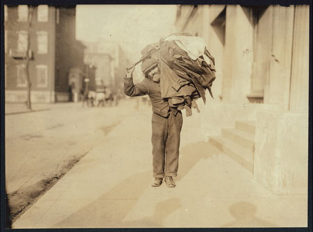 A modern Atlas. The Home-work Burden. Said he made button-holes at home. Washington Square, N.Y.  Location: New York, New York (State)