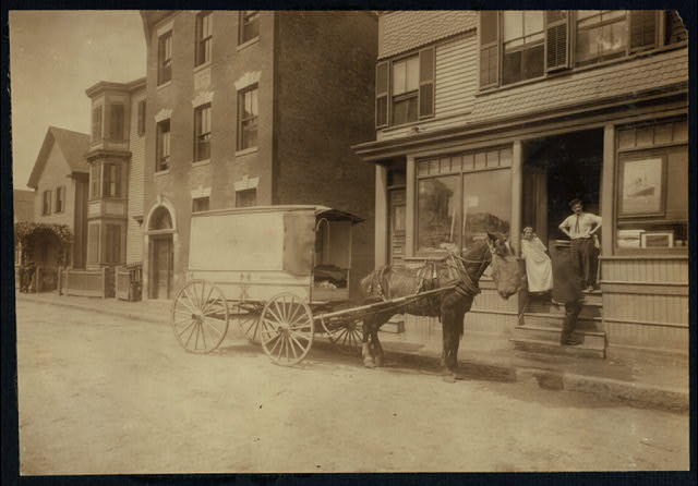 The wagon that delivers Home Work to Somerville, Mass. The owner of the wagon (who is not the driver) is O. H. Brown, 27 Main Street, Reading, Mass. These wagons (about 4 in all) are worked on commission, not owned by factory.  Location: Somerville, Massachusetts.