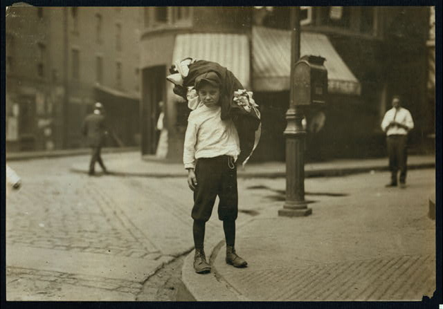 Vitto Romano, 76 Charter Street, Boston, Mass., carrying load of garments from 30 Blackstone Street. Said 12 years old and that only his mother finishes them.  Location: Boston, Massachusetts.