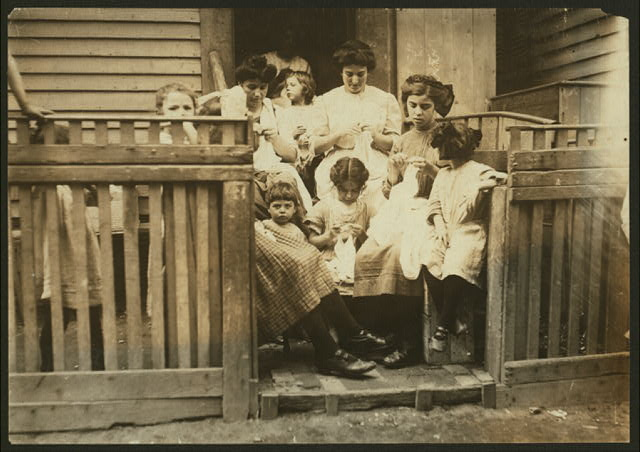 Typical group of Home Workers crocheting on steps, 16 South Street, Somerville, Mass.  Location: Somerville, Massachusetts.
