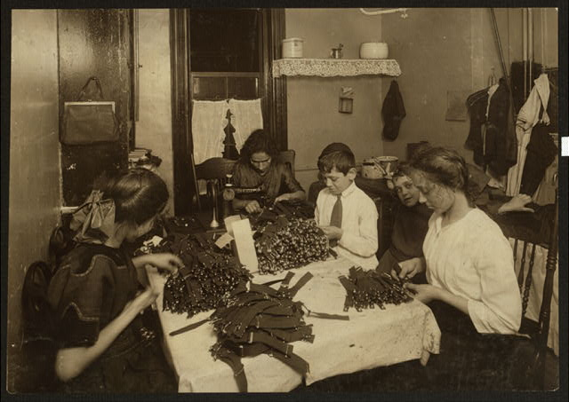 Jewish family working on garters in kitchen for tenement home. (For complete details see Miss E.C. Watson's report.)  Location: New York, New York (State)