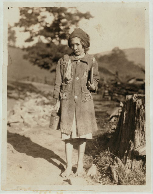 One of the poorer country girls on the way to Buckeye School. She belongs to the Aldrich family. (See Photo & Labels) Pocahontas Co., Mlinton, W. Va.  Location: Pocahontas County--Marlinton, West Virginia