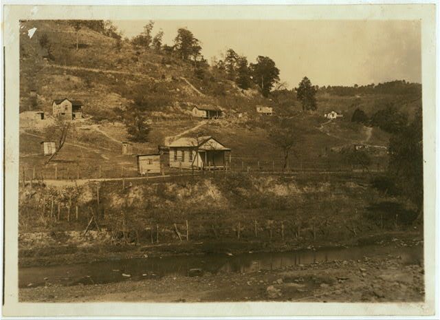 Slip Hill School - tiny one-room school in the country near Charleston; note the shacks on the hillside.  Location: Charleston [vicinity], West Virginia