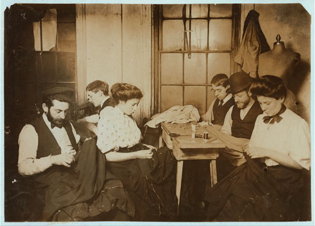 Group in Sweatshop. Mr. Schneider, 87 Ridge Street Shop located in the second inner court. Group just finishing week's work.  Witness Mrs. Lillian Hosford.  Location: New York, New York (State)