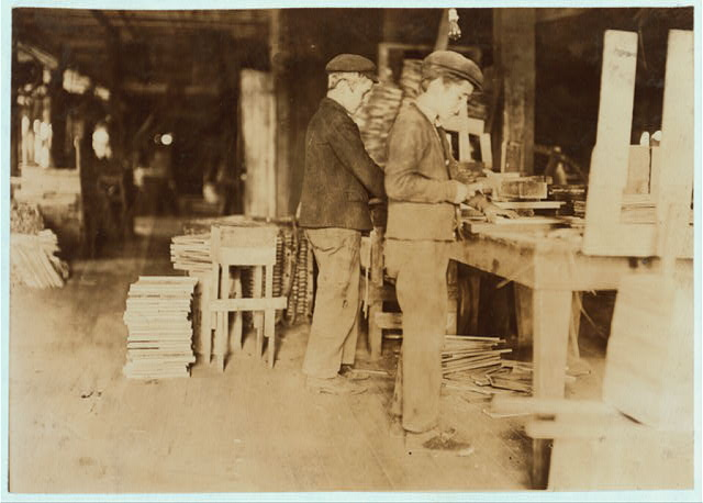 A Basket Factory. Boys making grate bottoms. In summer, many more young boys and girls.  Location: Evansville, Indiana.