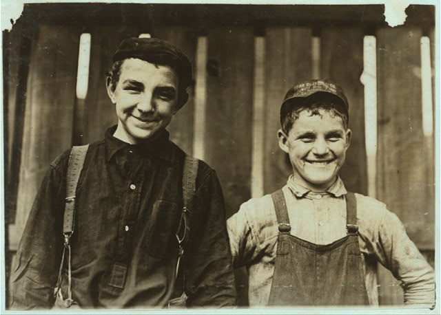 Going home to lunch! Two boys from Singer Mfg. Co., Small boy -- Charles Bailey, 316 Scholum St., Is he Fourteen years old?.  Location: South Bend, Indiana.