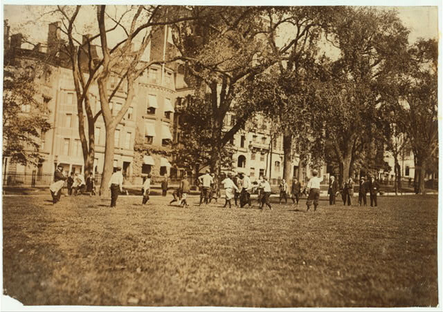 Amateur Football on the Boston Common.  Location: Boston, Massachusetts.