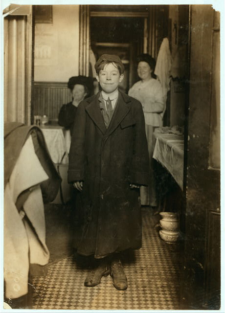 John Gannon (14 years old) 104 Cherry St. John cannot secure an employment certificate because he lacks weight and cannot pass the physical test; he is also under sized for his age; has passed the school requirements. Mother is a widow, does day's work and earns $3 a week. Mary, oldest daughter, fields envelopes at $4 a week. Two children in the orphan asylum. Mother struggling hard to get office cleaning, so that she may take the children out and have a home of her own, as at present they are lodging with friends. We are giving a scholarship to John.  Location: New York, New York (State)