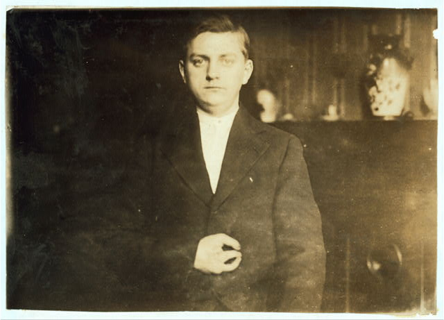 Case of Frank Wiegel, 3916 - # Ave., Brooklyn N.Y., injured after working 18 hours a day. He was injured at 1:55 A.M. January 18, 1914. Age 15 years. Employed by the Henry Bosch Paper Co., makers of wallpaper sample books. On Saturday, or rather Sunday morning at 1:55, Frank must have fallen asleep and in some way he knocked against the controlling pedal, and the next thing he knew his hand was caught in the machine. He sued the Co. for damages and after 2 years' litigation he received an award of $10,000 - $5,000 for each of 2 fingers which were amputated. The lawyer's fee has not yet been decided upon by the court.  Location: New York--Brooklyn, New York (State)