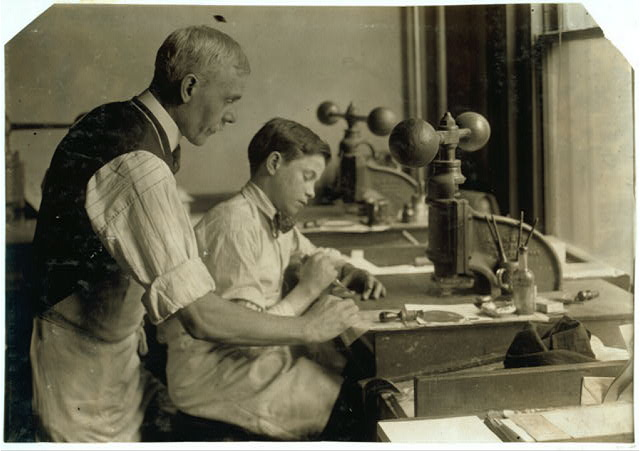 14-year old Fred cutting dies for a new job. Embossing shop of Harry C. Taylor. 61 Court Street.  Location: Boston, Massachusetts