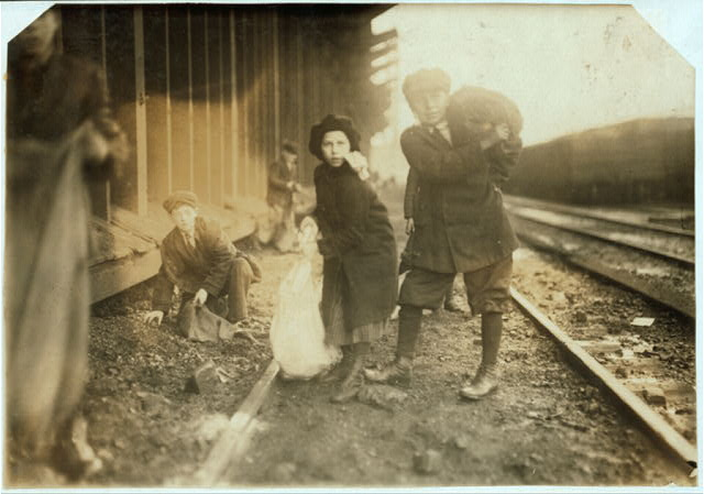 [Stealing coal from railroad coal-yard.]  Location: [Boston, Massachusetts].