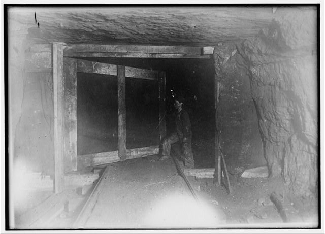 "Trapper Boy, ""Son."" Opens and closes door that controls ventilation. He is underground from 7 A.M. to 5:30 P.M. (Much of the work of mining, loading and carrying is dome [i.e., done] by machinery.) Boy has been trapping for several years. Asked if these boys did this one thing all the time, the boss said, ""Oh, they change around from one door ro [i.e., or] another.""  Location: West Virginia."