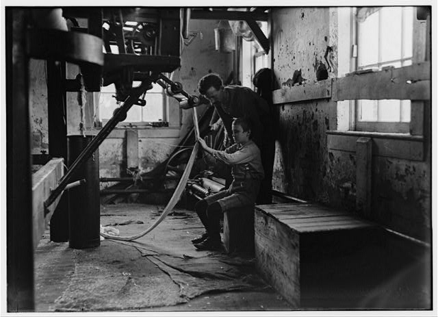 Newton Cotton Mill, Newton N.C. Boy at warping machine. Been there 2 years.  Location: Newton, North Carolina.