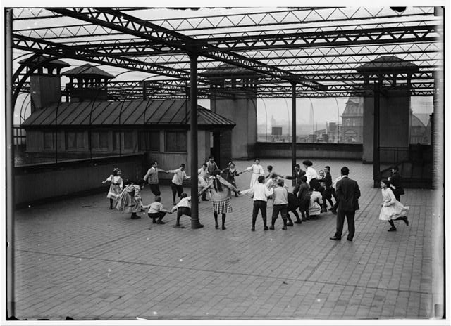 Immigrant Children Learning to Play on the Roof Garden of the Washington School. Boston 1915 Exhibit.  Location: Boston, Massachusetts.
