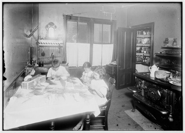 Home work on tags. Home of Martin Gibbons, 268 [?] Centre Street, Roxbury Mass. James 11, years old; Helen 9 years and Mary 6, work on tags. Helen said she could tie the most (5,000 a day at 30 cents). Mary does some but can do only 1000 a day. They work nights a good deal. The night before Helen and James worked until 11:00 P.M. See also Home Work report.  Location: Roxbury, Massachusetts.