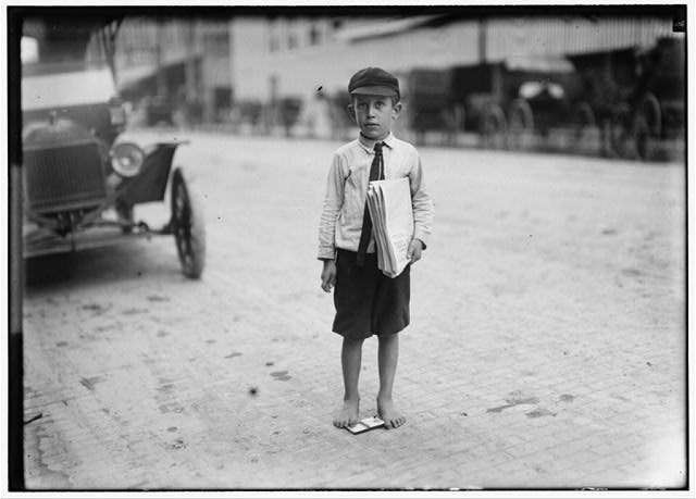 Eight year old newsie. Many youngsters get up early to sell papers. One ten year old starts out at 3 A.M. every day and goes to school.  Location: Waco, Texas.