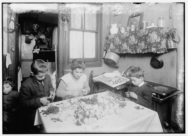 Mrs. A.L.A. She [?] & her 3 children - 11, 9, & 6 yrs old work at flower making. The 2 year [old?] is learning, & they say ought[?] to be able to help in a year or so. Mother receives a pension.  Location: [New York (State)].