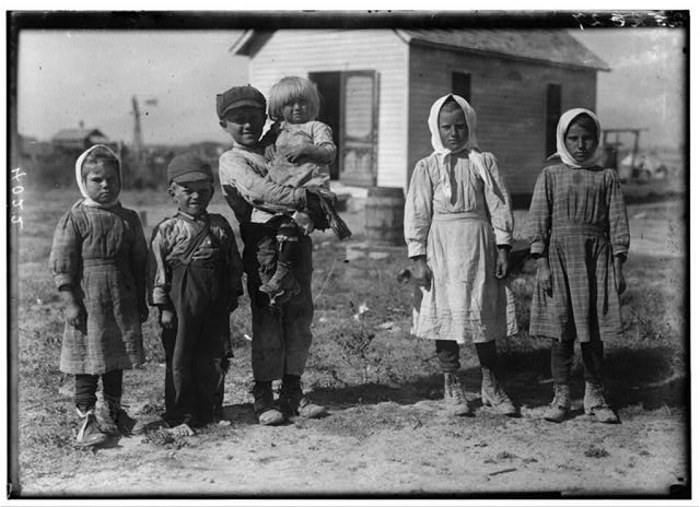 "[The 8 and 10 yr. old children here are working beets on a farm near Sterling, Colo, from 5:00 A.M. to 7:00 P.M. on rush days. Father said, ""We have to get done.""].  Location: [Sterling vicinity, Colorado]"