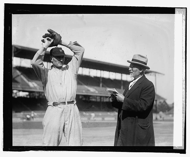 Walter Johnson poses while U.S.J. Dunbar sketches him, 10/2/24