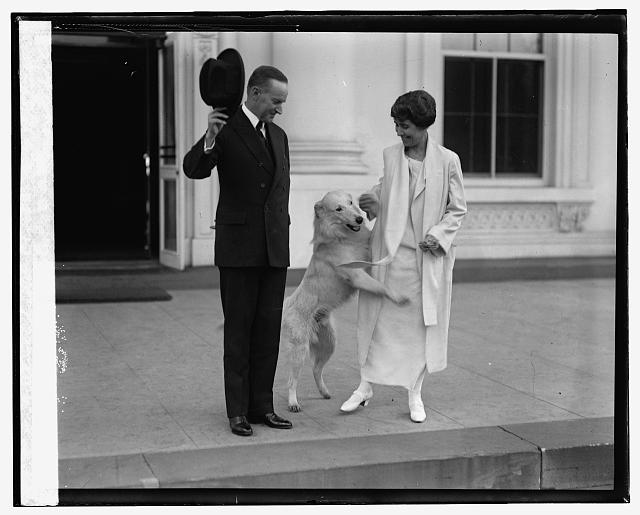 Pres. & Mrs. Coolidge acknowledge greetings from crowd, 11/5/24