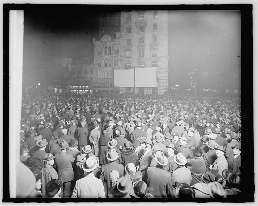 After some research I believe this is a photo of people on November 2nd, 1948 waiting for the results of the Presidential election between Truman and Dewey.