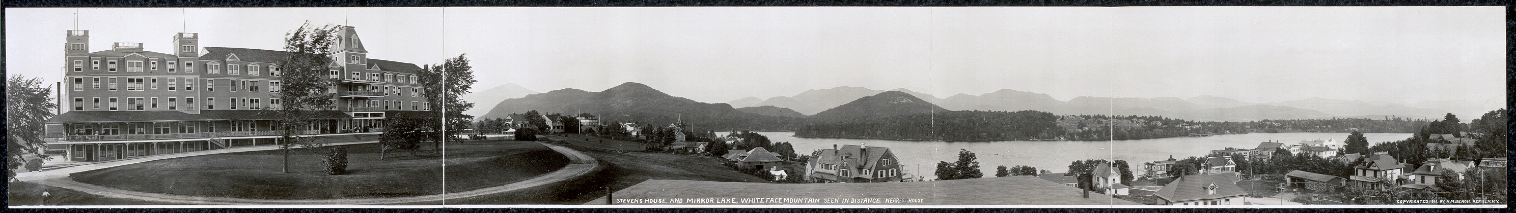 Stevens House and Mirror Lake, Whiteface Mountain seen in distance nearest house