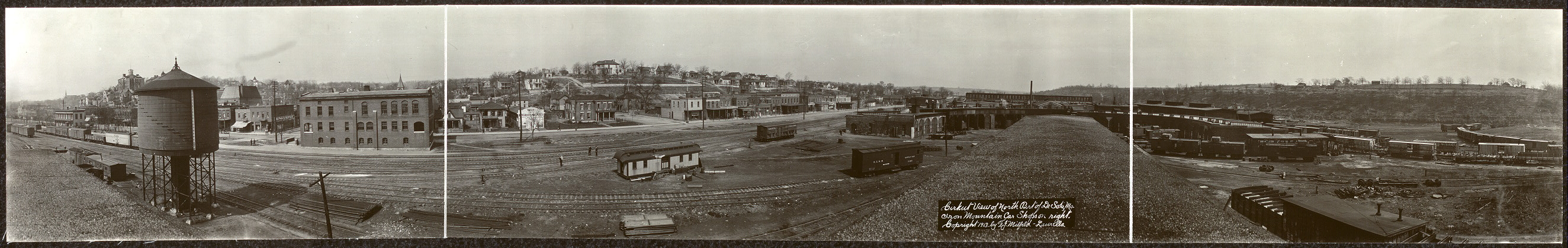Cirkut view of north part of De Soto, Mo., Iron Mountain car shops on right