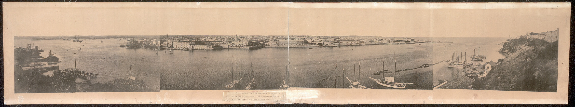 Panoramic view of Havana, showing the entrance to the harbor and inner harbor; taken from Cabanas Fortress showing Morro Castle on the extreme right-hand