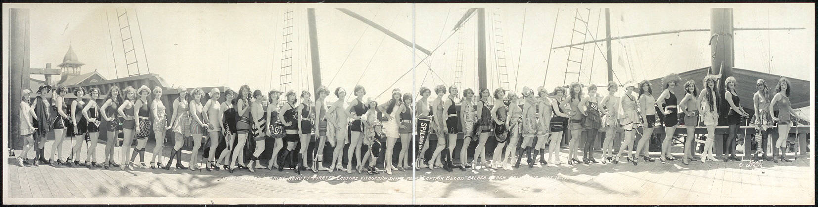 "Jewell Pathe's Bathing Beauty Pirates capture Vitagraph Ships for ""Captain Blood"", Balboa Beach, California, June 15, 1924"