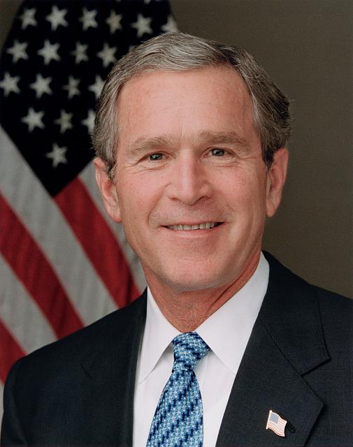President Bush poses for his official portrait in the Roosevelt Room (blue tie)