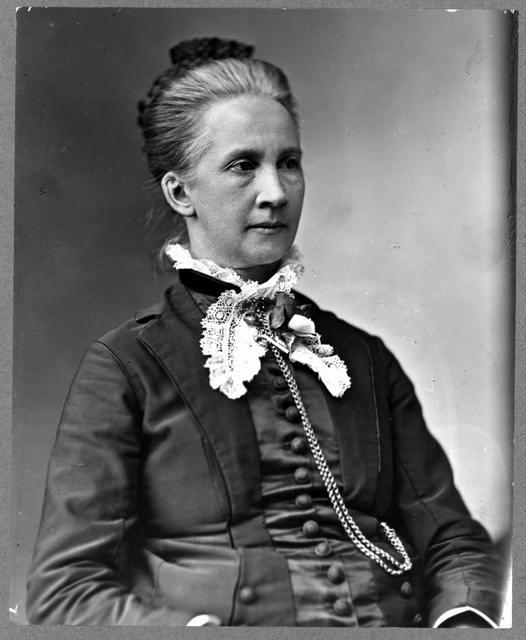 [Lawyer Belva Lockwood, half-length portrait, seated, facing right]
